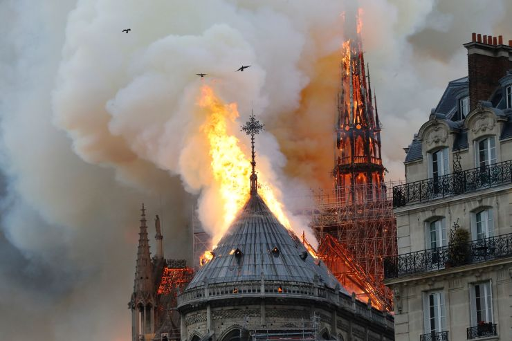 Smoke and flames rise during a fire at the landmark Notre-Dame Cathedral in central Paris on April 15, 2019, potentially involving renovation works being carried out at the site, the fire service said. Francois Guillot | AFP | Getty Images