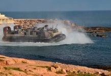 U.S. amphibious hovercraft departs with evacuees from Janzur, west of Tripoli, Libya