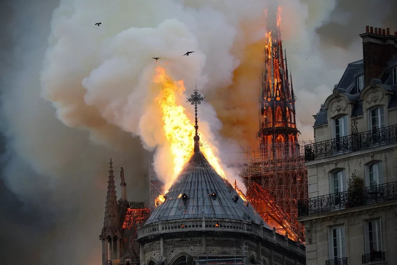 Flames and smoke are seen billowing from the roof at Notre Dame Cathedral.
