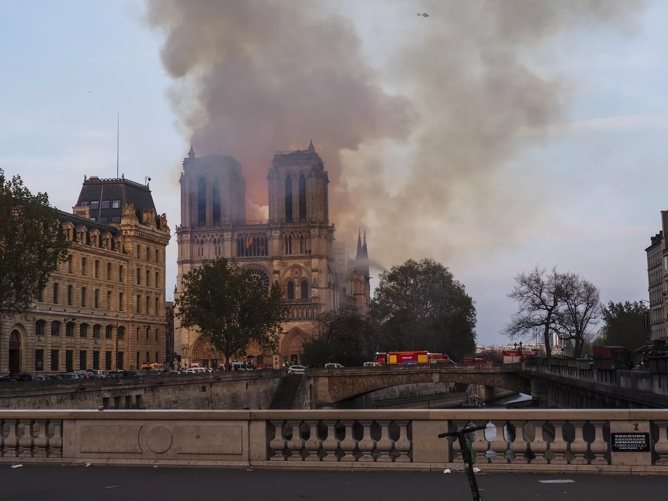 "A huge column of smoke stands above what the mayor of the French capital described as a ""terrible fire."""