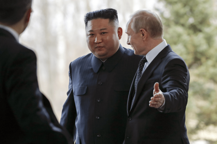 Russian President Vladimir Putin, right, welcomes North Korea's leader Kim Jong Un