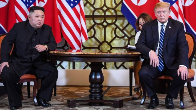 US President Donald Trump (R) holds a meeting with North Korea's leader Kim Jong