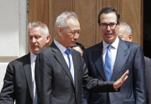 Chinese Vice Premier Liu He (2nd L) says goodbye to U.S. Treasury Secretary Steven Mnuchin as they break from meetings at the USTR offices May 10, 2019
