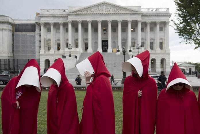Supporters of Planned Parenthood dressed as characters from