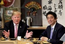 US President Donald Trump with Japanese Prime Minister Shinzo Abe during a dinner at a hibachi