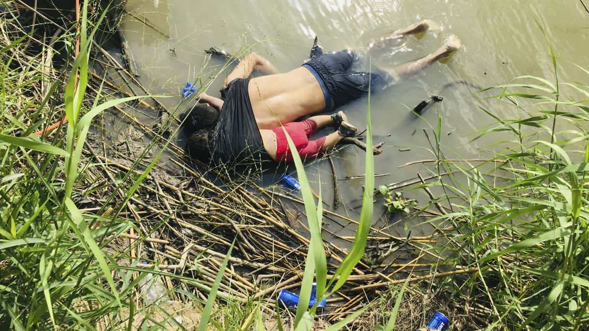The bodies of Salvadoran migrant Oscar Alberto Martínez Ramírez and his nearly 2-year-old daughter Valeria lie on the bank of the Rio Grande in Matamoros, Mexico, on Monday