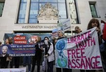 Supporters of WikiLeaks founder Julian Assange protest outside Westminster Magistrates' Court on Thursday